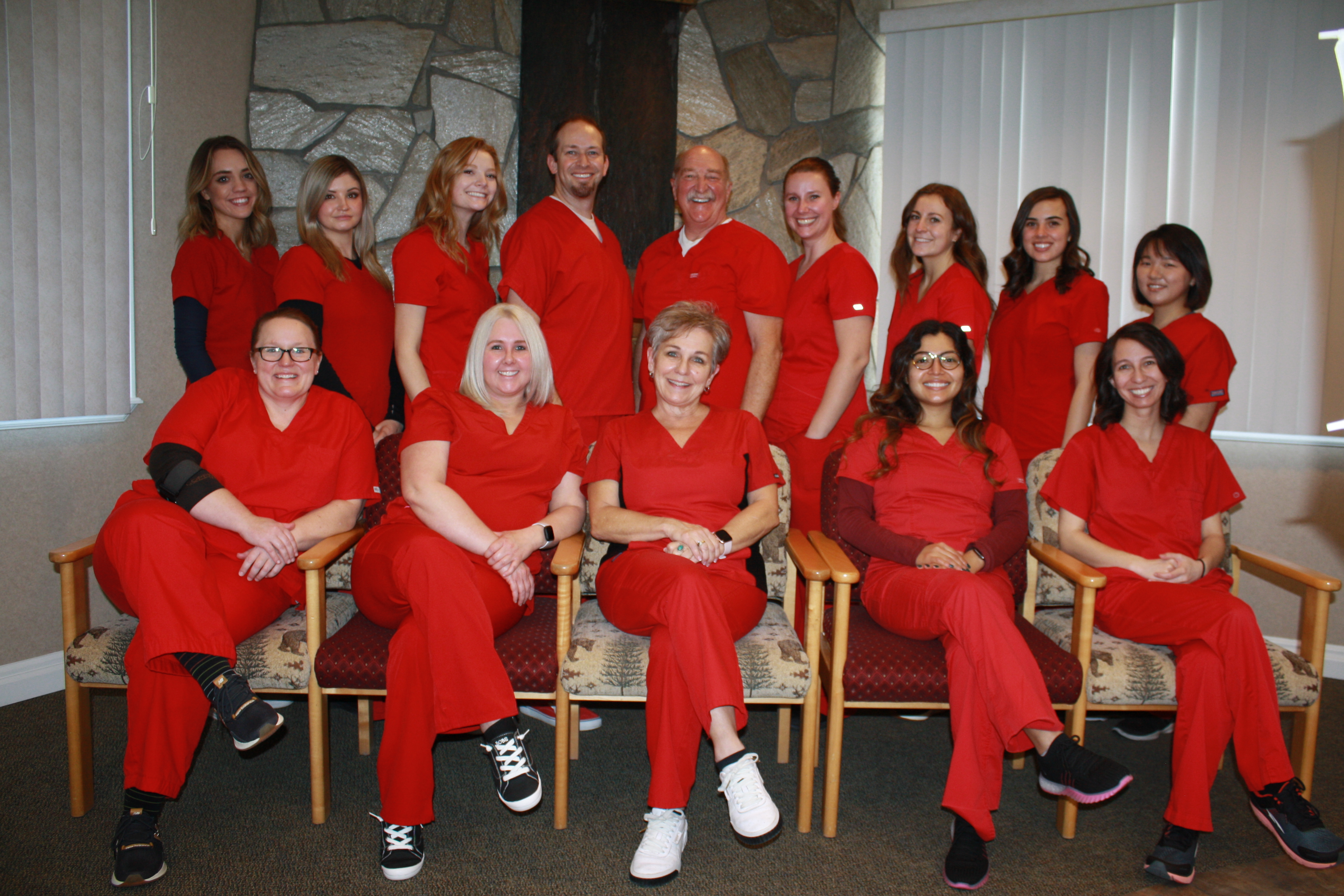 Mirci Dental Team all wearing red scrubs
